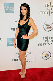 Angelique Cabral donned an emerald green bandage dress with nude platform pumps for the premiere of 'The Perfect Family' at the Tribeca Film Festival.