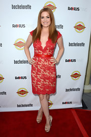 Isla Fisher was a vision at the 'Bachelorette' premiere in this red lace deep-V number.