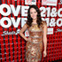 Long Wavy Cut Lookbook: Hayley Orrantia wearing Long Wavy Cut (2 of 5). Soft waves gave Hayley Orrantia a glamorous red carpet look at the '21 and Over' red carpet.