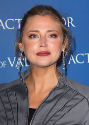 Estella Warren attended the premiere of 'Act of Valor' wearing a shiny golden raspberry lipstick.
