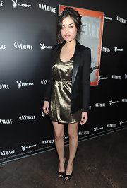 Sasha Gray tamed down her gold lamé dress with a sleek black blazer.