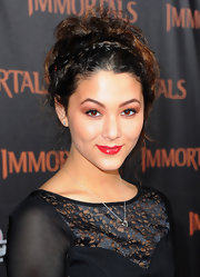Fivel Stewart had her hair styled in a romantic braided updo for the 'Immortals' premiere.