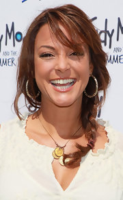 Eva la Rue completed her cool summer look with a loose braid at the 'Judy Moody' premiere.