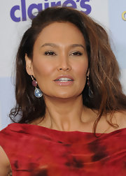 Tia Carrere styled her hair in a side-part and high-volume waves for the premiere of 'Mirror Mirror.'