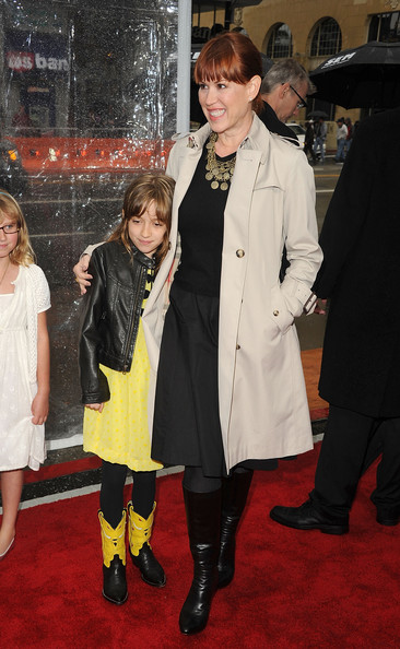 Molly Ringwald layered a beige trenchcoat over her black ensemble for a super-stylish finish.
