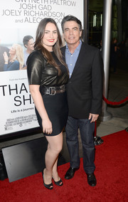 Kathryn Gallagher looked sexy-edgy on the red carpet in a tight-fitting black mini skirt and a leather top during the 'Thanks for Sharing' premiere.