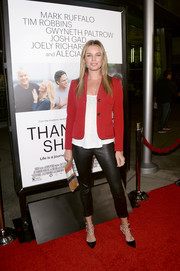 Rebecca Romijn looked snazzy on the red carpet in black leather cigarette pants teamed with a cropped blazer during the 'Thanks for Sharing' premiere.