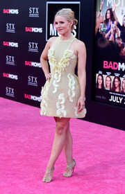 Kristen Bell shut down the red carpet in her pastel yellow Georges Chakra Couture above-the-knee frock at the 'Bad Moms' premiere.