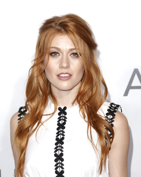 Katherine McNamara attended the premiere of 'Adrift' wearing her hair in a sexy half-up style.