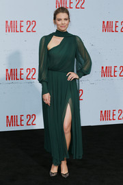 Lauren Cohan went for modern glamour in a forest-green cutout dress by Schiaparelli Couture at the premiere of 'Mile 22.'