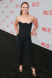 Ronda Rousey sheathed her figure in a strapless black jumpsuit by House of CB for the premiere of 'Mile 22.'