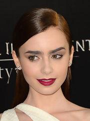A rich raspberry lip color popped against Lily's fair skin and ivory frock.