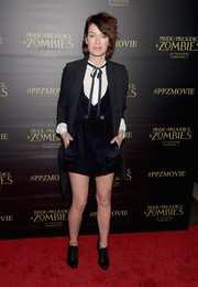 Lena Headey was youthful and preppy in a navy corduroy mini dress teamed with a white shirt and a Western string tie at the premiere of 'Pride and Prejudice and Zombies.'