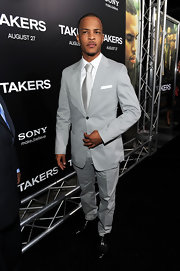 T.I. showed off a sophisticated side in an all grey suit.
