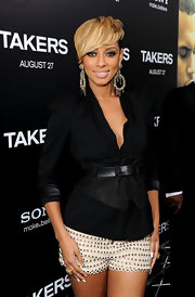 Looking impeccably chic, Keri Hilson paired her dress shorts with a belted blazer.