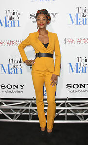 Yaya topped off her mustard suit with classic black suede pumps.