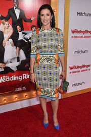 Mimi Rogers went all out with the colors, teaming her print dress with bright blue pumps.