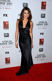 Lea Michele looked classically elegant in her black satin bias-cut gown with a draped cowl neck.