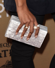 Kat Graham carried a pearlescent box clutch by Edie Parker at the premiere of 'American Horror Story: Hotel.'