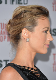 Natalie Zea topped off her look with a pair of Chanel double-C diamond studs.
