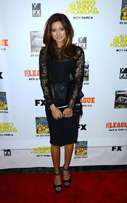Noureen DeWulf looked classy in a lace and leather peplum top matched with a pencil skirt at a movie screening.