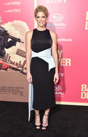 Ashley Greene went modern in a form-fitting black Peggy Hartanto dress with a contrast asymmetrical waistband at the premiere of 'Baby Driver.'
