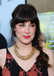 Lindsay Sloane wore her shiny hair in a cute side braid with lash-grazing bangs and wavy loose tendrils at the premiere of 'Darling Companion.'