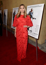 Elizabeth Olsen chose a loose red feather-embellished gown by Emilio Pucci for the premiere of 'I Saw the Light.'