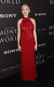 Michelle Williams was an elegant standout in a red halter gown by Louis Vuitton at the premiere of 'All the Money in the World.'