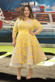 Melissa McCarthy looked absolutely darling at the 'Ghostbusters' premiere in a custom dress by Judy B Swartz and Daniela Kurrle, featuring yellow floral embroidery on a nude background.