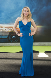 Kate McKinnon showed off her gorgeous figure in a slinky blue halter gown by Versace at the premiere of 'Ghostbusters.'