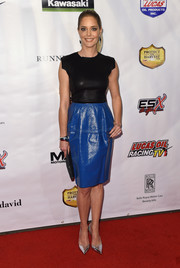 Christina Moore donned a chic combo leather dress for the premiere of 'Running Wild.'
