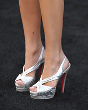 Kristin completed her spiked ensemble with metallic, platform Fortuna sandals.
