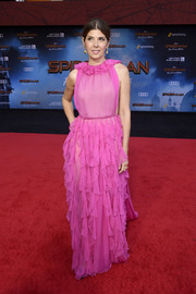 Marisa Tomei cut a sweet picture in a hot-pink Valentino gown with a ruffled neckline and skirt at the premiere of 'Spider-Man: Far From Home.'