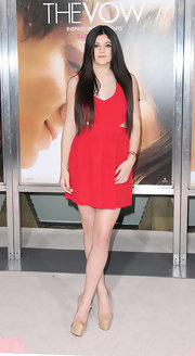 Kylie Jenner paired her red frock with nude platform Mary Jane pumps.