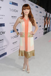 Bella wore her peach color-block dress with gold bracelets for 'The Vow' premiere.
