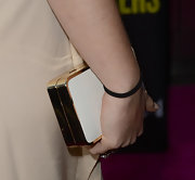 Sophie Simmons paired her cocktail dress with this gold and white hard case clutch for a sophisticated and modern look.
