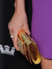 Eva Amurri added some sparkle to her matte dress with this gold metallic clutch.