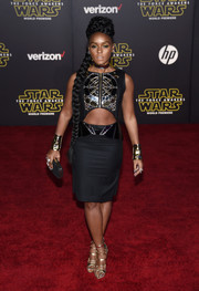 Janelle Monae matched her top with a black pencil skirt, also by Erevos Aether.