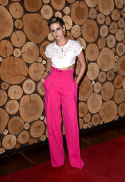Kristen Stewart teamed her top with high-waisted hot-pink trousers by Zuhair Murad.