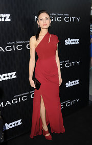 Olga Kurylenko arrived at the premiere of 'Magic City' wearing a pair of red platform shoes with banded detail.