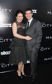 Lynn Collins paired pretty satin slingbacks with her tiered polka dot dress for the premiere of 'Magic City.'