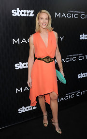 Kelly Lynch wore this tangeringe draped dress with a gold statement belt to the 'Magic City' premiere.