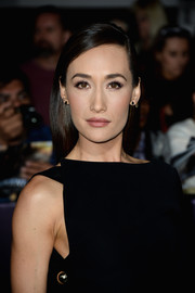 Maggie Q wore her hair sleek straight with a deep side part during the 'Divergent' premiere.