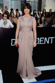 Amy Newbold was all glammed up in a floor-sweeping lilac gown during the 'Divergent' premiere.