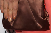 Petra played up the tonal hues of her clutch with a shiny bronze nail polish.
