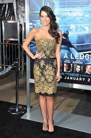 Genesis Rodriguez looked smashing in a gold and black lace cocktail dress for the 'Man on a Ledge' premiere.