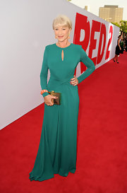 Helen Mirren stunned in a long-sleeve, draped gown that featured a vertical cutout detail.