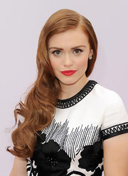 A classic red lip complemented Holland's retro-glam look.