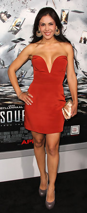 Carla was daring in a deep plunging red satin cocktail dress at the premiere of 'Source Code.'